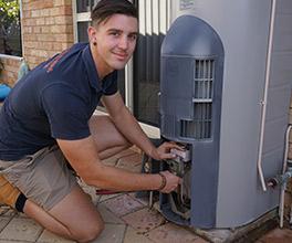 plumber repairing hot water system